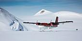 Twin Otter aircraft landing,Antarctica