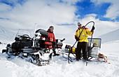 Glaciologists drilling on a glacier