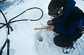 Glaciologist measuring a glacier