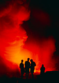 People watching a lava flow,Hawaii
