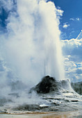 Water and steam erupting from a geyser