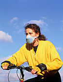 Cyclist wearing face mask to filter out fumes