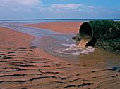 Sewage pipe on a beach