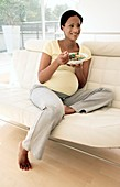 Pregnant woman eating a salad