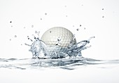 Golf ball splashing into water,artwork