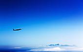 Aeroplane flying in a clear blue sky