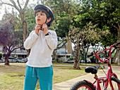 Boy of seven rides a bicycle