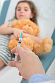 Girl in bed,person holding injection