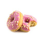 Pink doughnuts,one with a missing bite