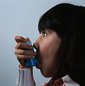 Young child using Brycanyl inhaler for asthma
