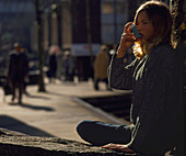 Teenager using an aerosol inhaler for asthma