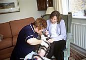 Nurse treating a patient's broken leg