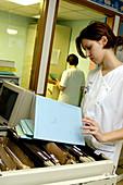 Nurse checking records