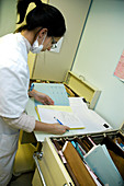 Doctor checking records