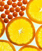 View of vitamin C pills and orange slices