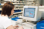 Pharmacist keeping records