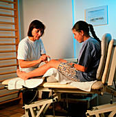 Ultrasound physiotherapy on a girl's knee