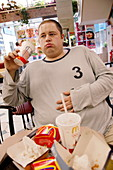 Obese man eating