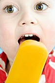 Toddler licking an ice lolly