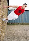 Man jumping off a wall