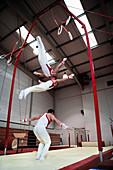 Gymnast performing on rings