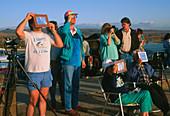 Amateur astronomers observing a solar eclipse