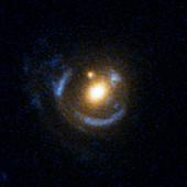 Galactic gravitational lensing,HST image