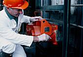 Wipe testing a radioactive level gauge
