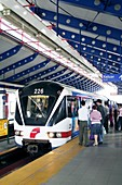 Passengers boarding a train,Malaysia