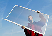 Man holding a transparent gasotrope window