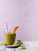 A green smoothie with mango and lettuce
