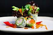 Maki with surimi, caviar and salad