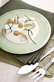 Plaice rolls with white grapes and Bechamel sauce