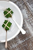Salmon parcels wrapped in spinach leaves