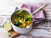 Vegetarian curry with broccoli, aubergines, tofu and chickpeas