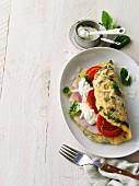 Basil omelette with ham, cream cheese and tomatoes