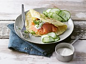 Sesame seed omelette with smoked salmon, cucumber and a yoghurt dip