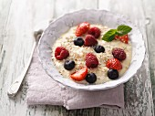 Mango quark with berries and buckwheat grits