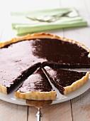 Chocolate tart, a piece cut