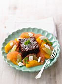 A brownie with citrus compote and goat's cream cheese