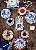 An East Frisian teatime meal with a waffle heart, blueberries and tea