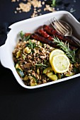 Spelt salad with merguez sausage, rosemary and lemon