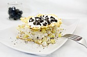 Millefeuille with fish, potatoes and black olives