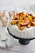 Peach and pistachio pavlova