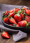 Strawberries in a black bowl