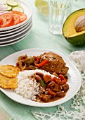 Braised chicken with beans, rice and tostones (Dominican Republic)