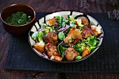 Pork bites with lettuce, green and broad beans
