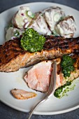 Grilled salmon with herb butter and potatoes