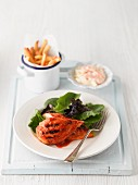 Peri peri chicken served with salad, fries and coleslaw