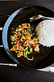Chicken curry with Thai basil, aubergines and beans with rice